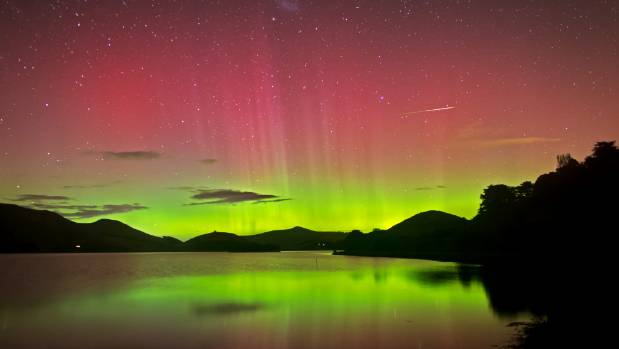 A spectacular auroral display viewed from the Otago Peninsula in April 2015. Aurora can interfere with the Earth's ...