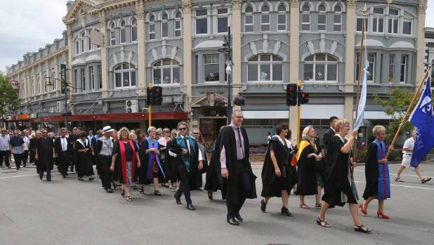 Students and staff take to Stafford St for the final Aoraki Polytechnic graduation parade.