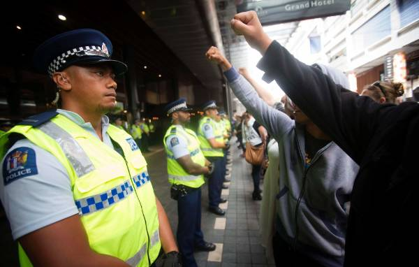 Police and protesters outside SkyCity.