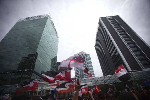 Protesters, many waving Maori sovereignty flags, made their way down to Britomart.
