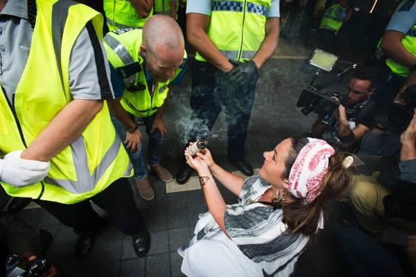A woman burns incense outside SkyCity.