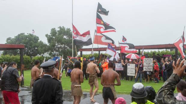 A hikoi of protesters, many opposing the TPPA, were welcomed onto the wet Waitangi lower marae.
