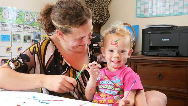 Talia Burton-Walker has decided to unschool her children. She and daughter India Walker, 2, do some painting.