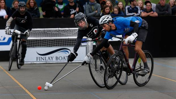 Paul Vergnaud, left, races Brun-Pierre Yves for the ball at the final of the World Hardcourt Bike Polo Championships.