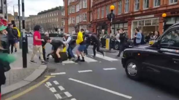 Kiwi pub crawlers getting into a scrum on a pedestrian crossing on London's Cliveden Place.