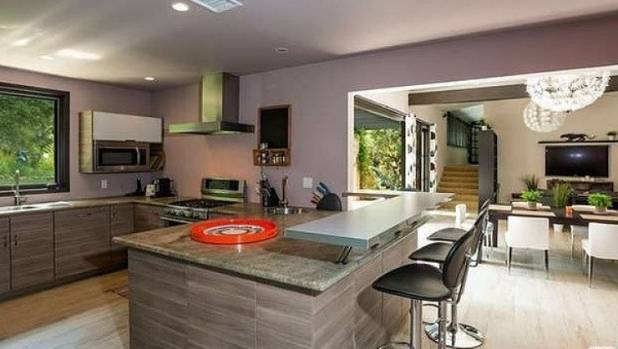The home has four bedrooms and three bathrooms, with a granite-topped kitchen.