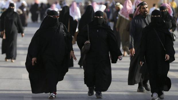 Women in Saudi Arabia must wear long, loose robes in public, and most also cover their hair and face with a black veil.