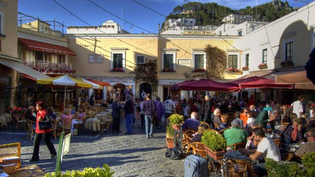 Stumbling upon a picturesque square is likely to happen in Italy.