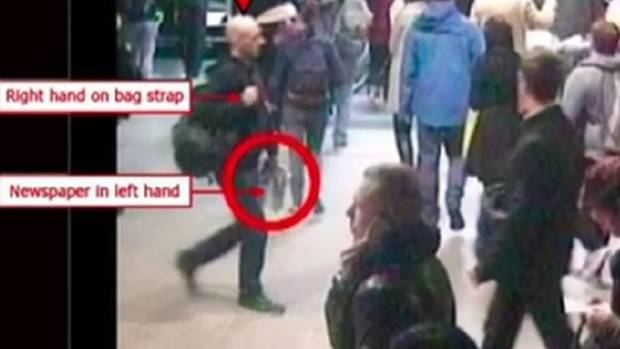 CCTV footage shows Mark Pearson never took his hands off his bag or his newspaper.