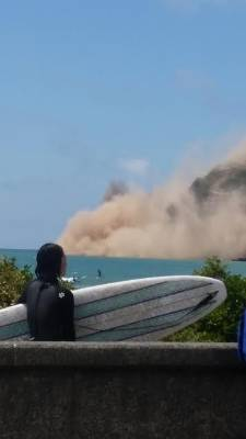 Dust rises over the beach following the 5.7 earthquake near Christchurch on Sunday.