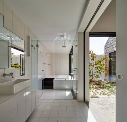 Bathrooms feature crisp white tiles and fittings.