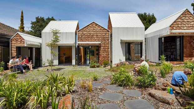 While the house appears from the outside as a collection of small volumes, on the inside it opens up to reveal large ...