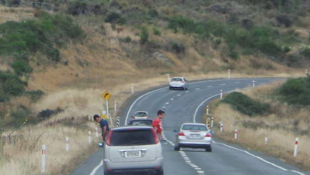 A driver on State Highway 6 in Southland was shocked with what appeared to be two men urinating from a moving vehicle.