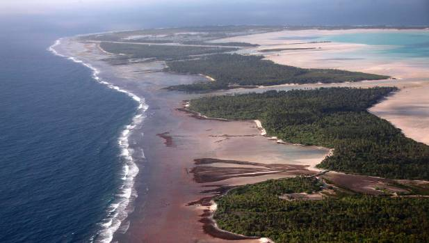 North and South Tarawa in Kiribati from the air. With surrounding sea levels rising, some scientists are predicting ...
