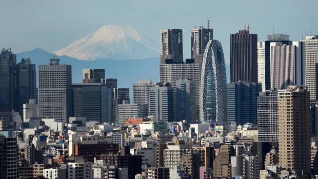 A view of the skyscrapers of Shinjuku with Mount Fuji in the background.