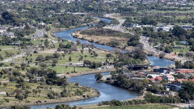 The picturesque Avon River winds through the residential red zone.