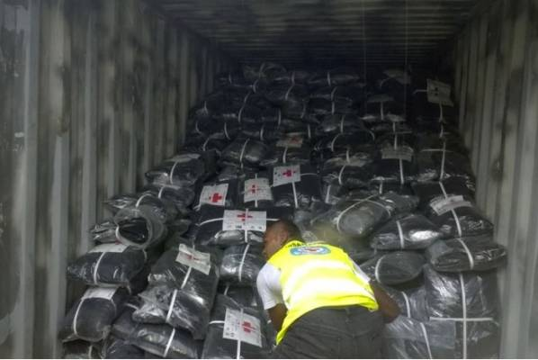 Fiji Red Cross workers prepared aid ahead of the storm hitting.