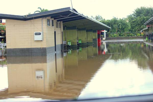 The Nadi bus stop submerged in water.