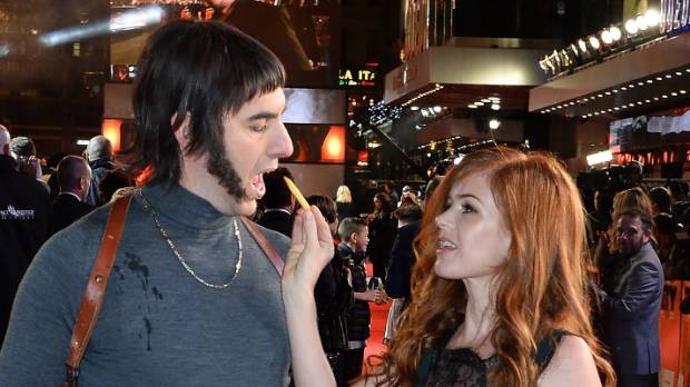 "Sacha Baron Cohen as Norman ""Nobby"" Grimsby and Cohen's wife, Isla Fisher, at the Grimsby premiere."
