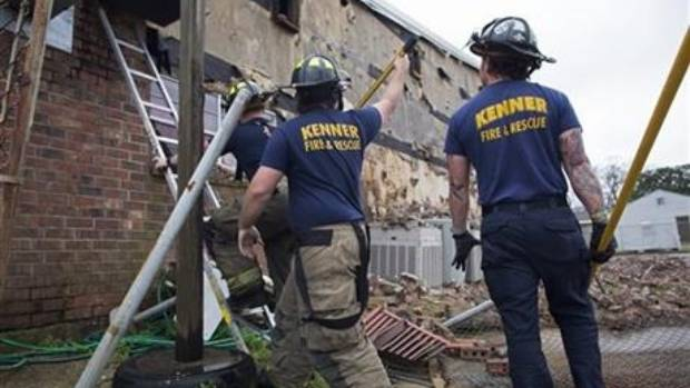 Members of the Kenner Fire Department knock down bricks from the wall of the New Mount Bethel Baptist Church, which ...