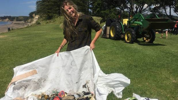 Jamie McDell with some of the rubbish picked up from around Motuihe Island.