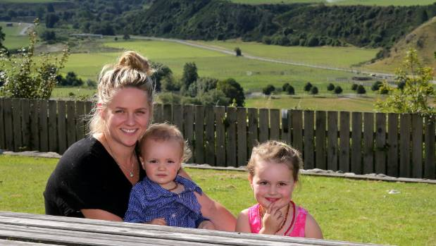 Chanelle with children Hunter and Isabelle. Living in the country with young children goes hand in hand with isolation.