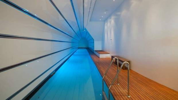 It features an extra covered lap pool on top of a spectacular open-air pool.