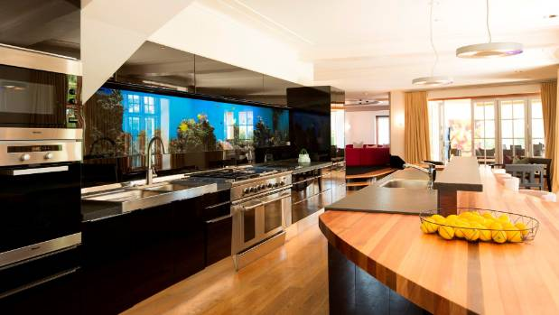 There's no reason for boredom among the kitchen staff with a vast aquarium built into the wall over the kitchen range.