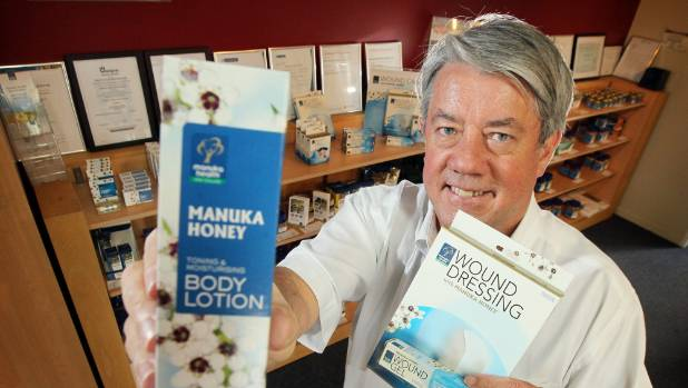 Manuka Health founder Kerry Paul shows off his company's products.