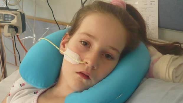 Grace is making huge progress but there's a long way to go, her mother warns. She is pictured on one of the many tough, ...