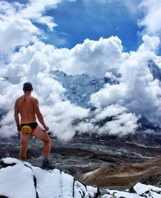 Even a chilly day can't keep this traveller away from his skimpy briefs.