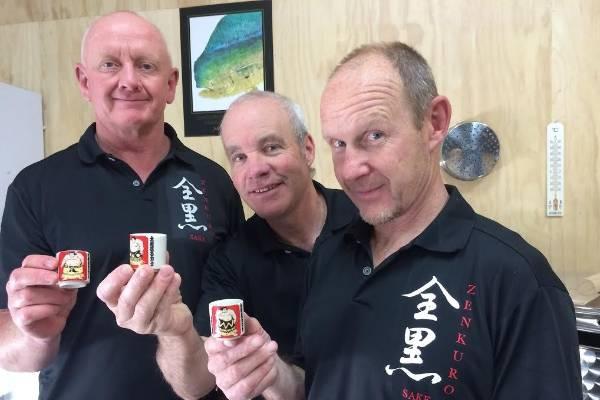 From left Craig McLachlan, Richard Ryall and David Joll toast to Zenkuro's success.