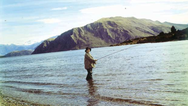 Overseas visitor the Queen Mother fishing at Lake Wanaka in 1966. Her visit predated the current licensing system, so ...