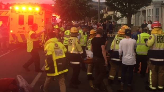 Eight people are seriously injured after a balcony collapsed during a Six60 concert on Dunedin's Castle St.