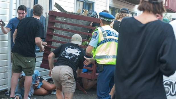 Police and bystanders rush to help after the balcony collapsed