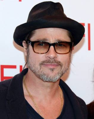 We're not sure if that counts as a beard on Brad Pitt, but either way - it needs to go.