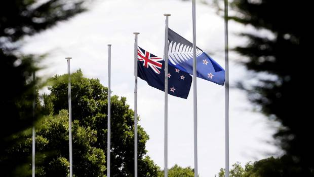 The two alternative flag fly outside Fonterra, Palmerston North.  By the end of this month, there can be only one ...