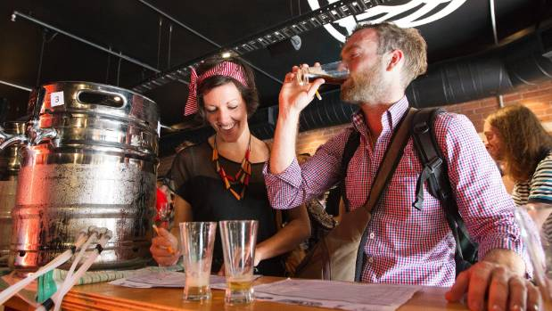 Erica McGinniskin and Nathan Power blind judge beers at the NZ (the All Hops) v Australia (the Wallabeers) craft beer ...