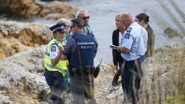 Police and ambulance staff at a beach near Island Bay in Wellington, where a 37-year-old woman died while diving.