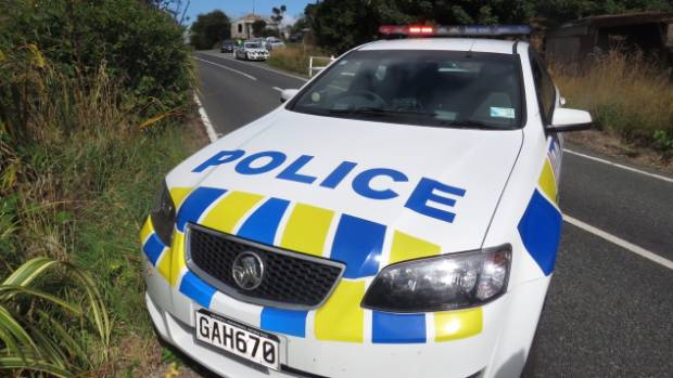 Police at a cordoned off scene at Seacliff, near Dunedin.