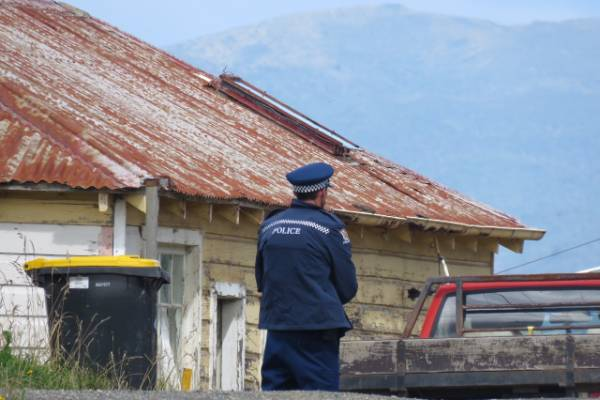 .Police at a property where a woman's body was found at Seacliff, near Dunedin
