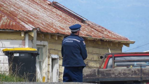 A police officer at a Seacliff property, near Dunedin.