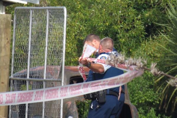 Police cordon off a property at Seacliff, near Dunedin.