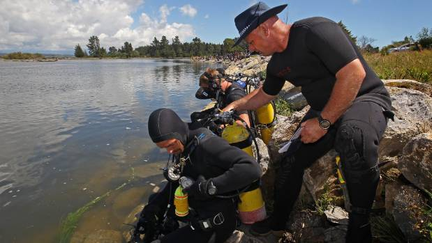 Senior Sergeant Bruce Adams, right, and his police national dive squad travel around the country searching for people ...