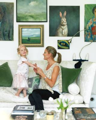Bridget and her daughter Clara in the sitting room. The rabbit portrait is by local artist Joanna Braithwaite.