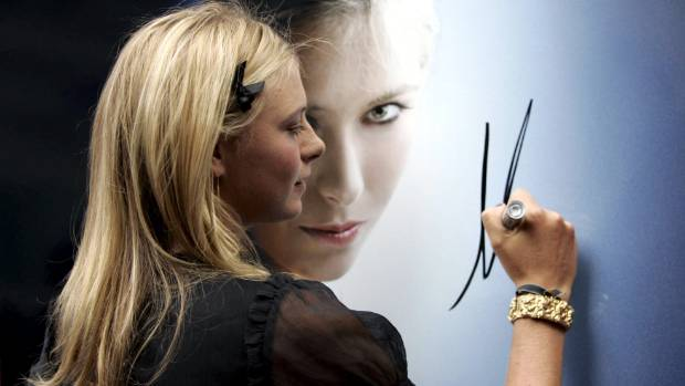 Maria Sharapova signs a poster before launching a TAG Heuer watch in 2006.