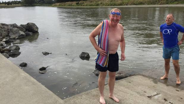 Environment Minister Nick Smith, left, with National list MP Jono Naylor just before taking the plunge in the Manawatu River.