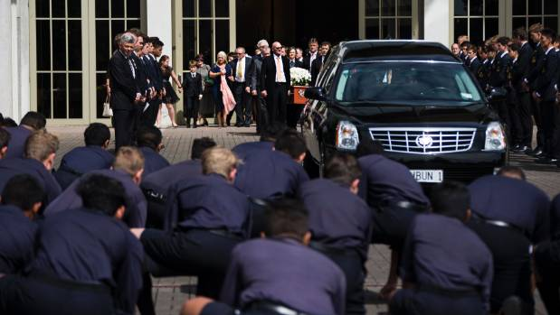 Auckland Grammar students perform a haka at the funeral of Martin Crowe.