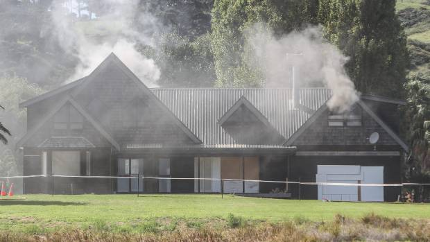 Fire crews start their training on a Waiheke home that used to belong to Mark Hotchin.