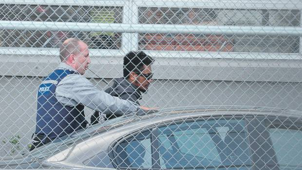 Rhys Warren being taken into custody after last year's siege.